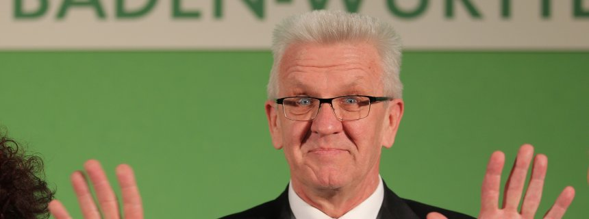 STUTTGART, GERMANY - MARCH 13:  Winfried Kretschmann, incumbent governor of Baden-Wuerttemberg and member of the German Greens Party (Buendnis 90/Die Gruenen), celebrates after the Baden-Wuerttemberg state elections on March 13, 2016 in Stuttgart, Germany. State elections taking place today in three German states: Rhineland-Palatinate, Saxony-Anhalt and Baden-Wuerttemberg, are a crucial test-case for German Chancellor and Chairwoman of the German Christian Democrats (CDU) Angela Merkel, who has come under increasing pressure over her liberal immigration policy towards migrants and refugees. The populist Alternative fuer Deutschland (Alternative for Germany, AfD), with campaign rhetoric aimed at Germans who are uneasy with so many newcomers, has solid polling numbers and will almost certainly win seats in all three state parliaments.  (Photo by Thomas Niedermueller/Getty Images)