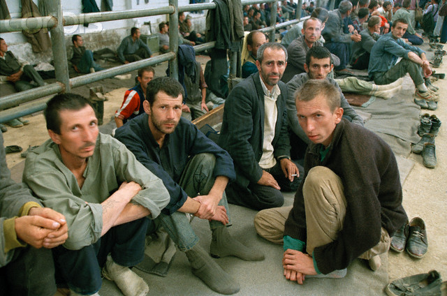 August 1992, Manjaca, Bosnia and Herzegovina --- Prisoners of War in Serbian Military Camp --- Image by © Isabel Ellsen/Corbis